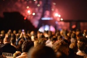 People at h Eiffel Tower at night, watch out for pickpockets and thieves