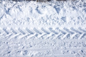snow tire tracks How to protect your home while on vacation