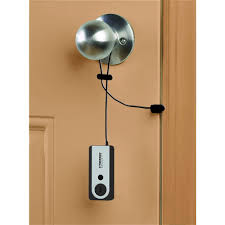 is it safe to stay in a hotel alone as a woman, portable door alarm