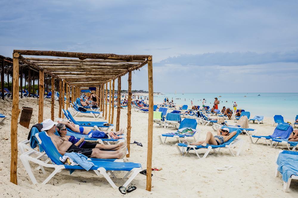 Crowded beach tourists